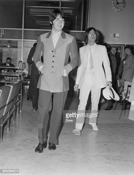 British musicians of the Beatles, Paul McCartney and John Lennon at Heathrow Airport, London, UK, 12th May 1968.