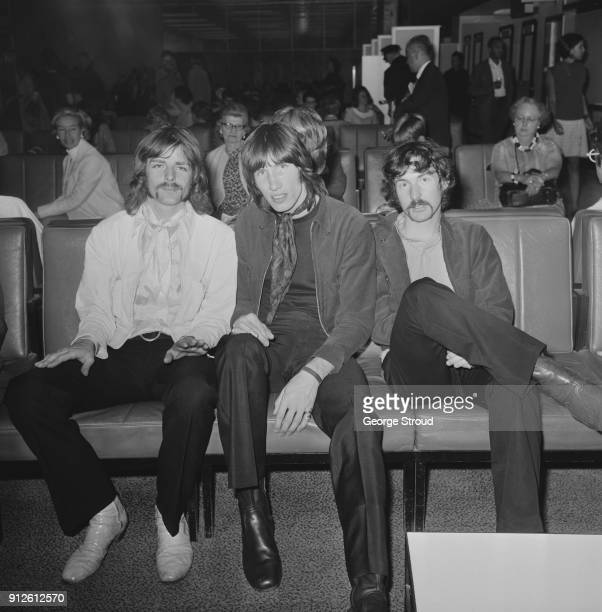 British musicians Richard Wright Roger Waters and Nick Mason of rock group Pink Floyd at Heathrow Airport before leaving for a 22date US tour London...