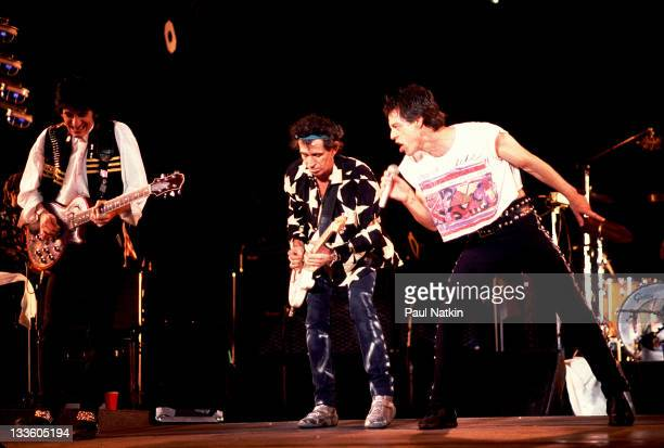 British musicians Ron Wood Keith Richards and Mick Jagger of the Rolling Stones perform on stage during the band's 'Steel Wheels' tour late 1989