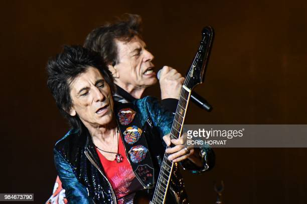 British musicians Ronnie Wood and Mick Jagger of The Rolling Stones perform a concert at The Velodrome Stadium in Marseille on June 26 as part of...