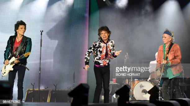 British musicians Ronnie Wood Mick Jagger and Keith Richards of The Rolling Stones perform a concert at The Velodrome Stadium in Marseille on June 26...