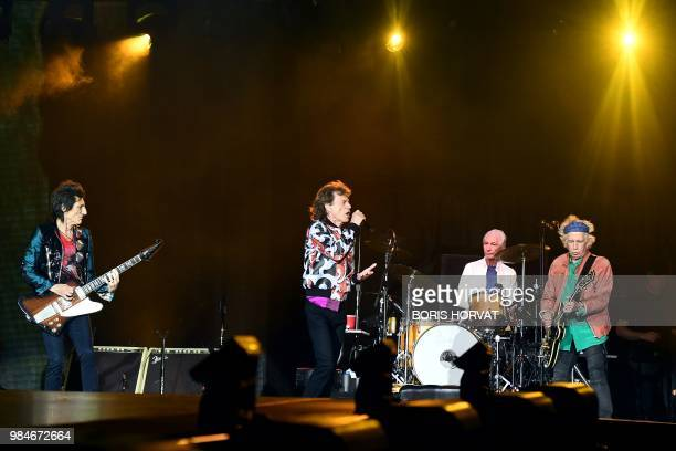British musicians Ronnie Wood Mick Jagger Charlie Watts and Keith Richards of The Rolling Stones perform during a concert at The Velodrome Stadium in...
