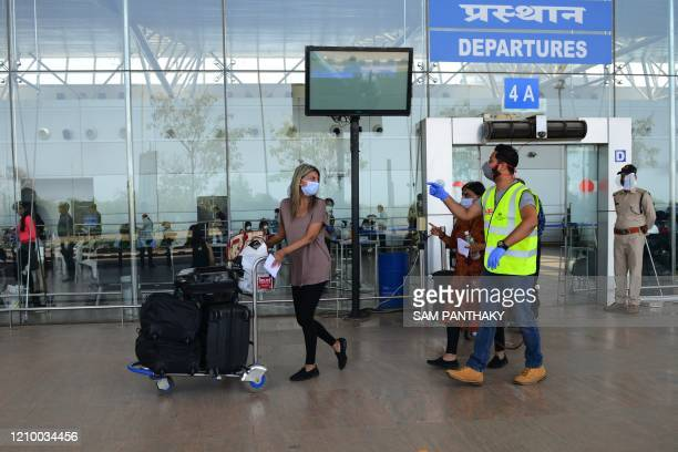 A British national arrives at the departure terminal before boarding a special British Airways flight bound to London during a governmentimposed...