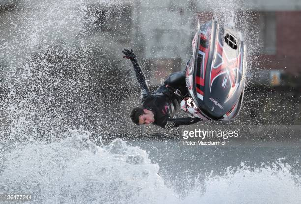 British National Freestyle Jet Ski Champion, 17 year old Jack Moule, performs stunts in the dock at The London Boat Show at The ExCel Centre on...