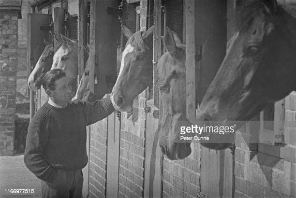British National Hunt racing racehorse jockey and trainer Fred Winter at a horse stable, UK, 2nd April 1965.