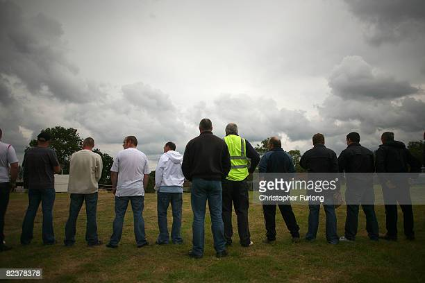 British National Party members line up to protect their festival as protestors march past the BNP's annual Red White and Blue Festival on August 16...