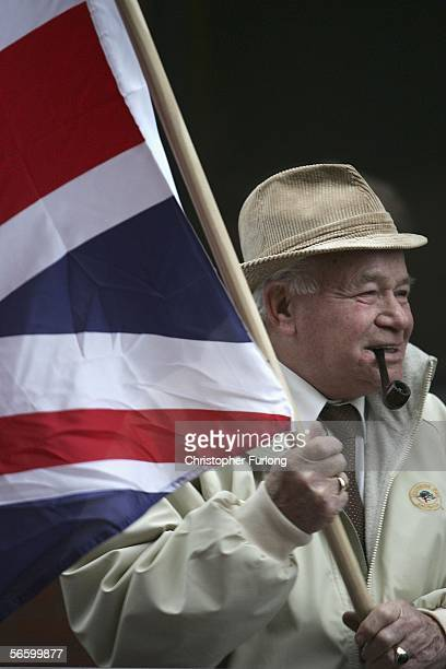 British National Party supporter waves a Union flag at antifascism protesters as Nick Griffin leader of the British National Party arrives at leeds...