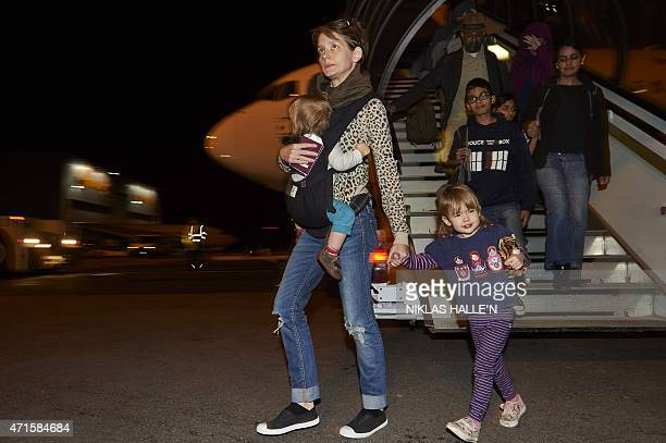British nationals arrive at London Stansted Airport on April 30 2015 after they were evacuated from Nepal following a 78 magnitude earthquake that...