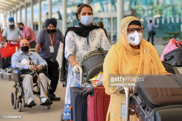 British nationals queue before checking-in for a special flight to London after the government eased a nationwide lockdown imposed as a preventive...