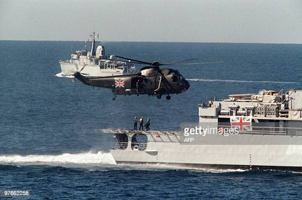 A British Navy Sea King helicopter lifts off from the back of a British warship 06 December 1987 as a British military convoy of 4 warships make...