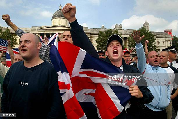 British neofascists shout racist abuse August 25 2002 during a 'Rally For Islam' demonstration held by AlMuhajiroun a UK based Muslim pressure group...
