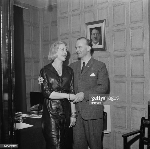 British neoNazi politician Colin Jordan and French socialite Francoise Dior UK 7th October 1963 she is wearing a swastika shaped pendant and behind...