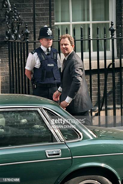 British new Prime Minister Tony Blair steps from his official limousine outside 10 Downing Street 03 May 1997 following his nomination as Prime...