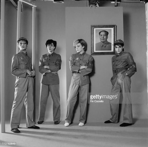 drummer Steve Jansen synthesizer player Richard Barbieri singer David Sylvian and bassist Mick Karn posing for a studio portrait against a wall onto...