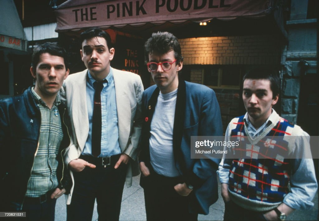 British new wave group The Fabulous Poodles outside The Pink Poodle Cocktail Loung on 6th Avenue, New York City during a US tour, March 1979. Left to right: bassist Richie Robertson, violinist Bobby Valentino, lead singer/guitarist Tony de Meur and drummer Bryn Burrows. Tony De Meur later worked as a stand up comedian as well as a musician, under the name Ronnie Golden.