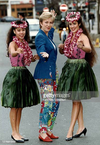 British newsreader and television presenter Jill Dando poses with two young women in leis circa 1993 She became known for presenting several...