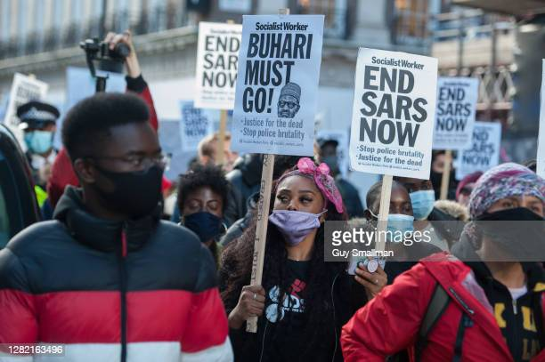 British Nigerians and fellow supporters march through central London to demand an end to the violence in Nigeria and the disbanding of the SARS...