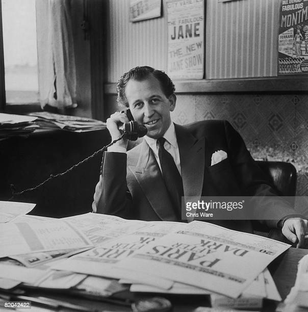 British nightclub owner and publisher Paul Raymond in his office, September 1956.