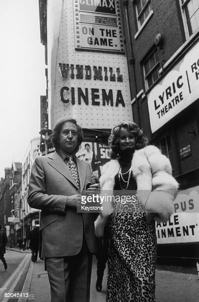 British nightclub owner and publisher Paul Raymond with his girlfriend actress and glamour model Fiona Richmond outside the Windmill Cinema in...