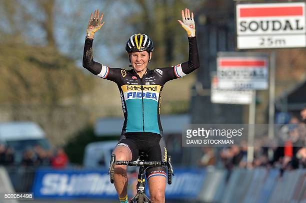 British Nikki Harris celebrates after winning the women's elite race in the fourth stage in the World Cup cyclocross on December 20 2015 in Namur...