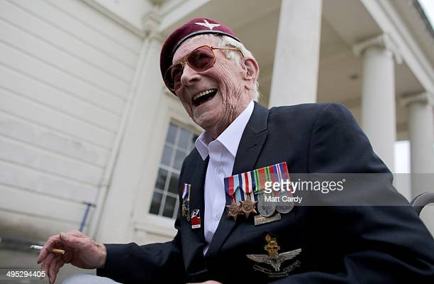 British Normandy Veteran Raymond Shuck who was a paratrooper on DDay laughs as he talks with fellow veterans outside Southwick House which in June...