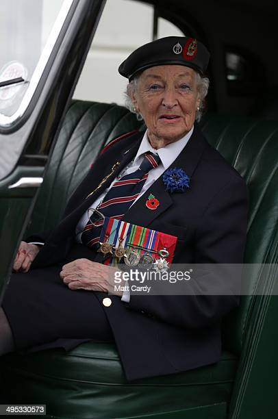 British Normandy Veteran Vera Hay who was a nurse in a field hospital shortly after DDay poses for a photograph sat in a Rolls Royce car that was...