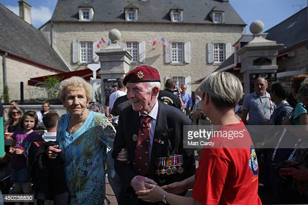 British Normandy Veterans are greeted by people as they visit SainteMereEglise which is holding DDay Commemorations on June 7 2014 in Normandy France...
