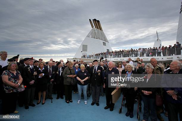 British Normandy Veterans passengers and crew take part in a wreath laying ceremony at sea on board the Brittany Ferries Mont St Michel as it leaves...