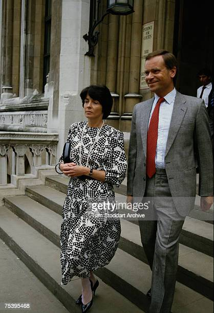 British novelist and statesman Jeffrey Archer and his wife Mary leave the law courts during his libel case against 'The Daily Star', 14th July 1987....