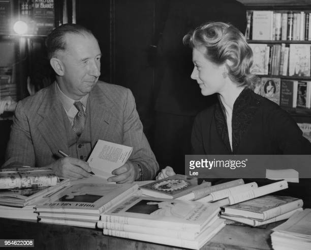 British novelist Nevil Shute and actress and ballet dancer Moira Shearer sign copies of their books in Harrods book department London in aid of the...
