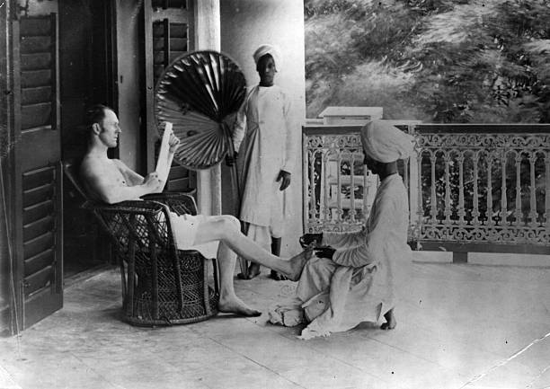 A British officer in India receives a pedicure from...