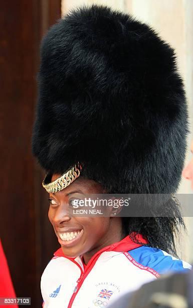 British Olympic 400m gold medallist Christine Ohuruogu wears a Guardsman's bearskin as she attends the British Olympic and Paralympic Heroes Parade...
