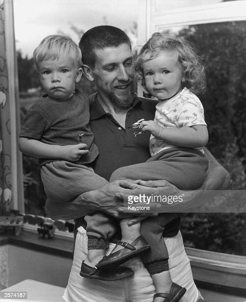 British Olympic 5000 metres runner John Herring at home with his two yearold twins Simon and Sarah 3rd August 1964
