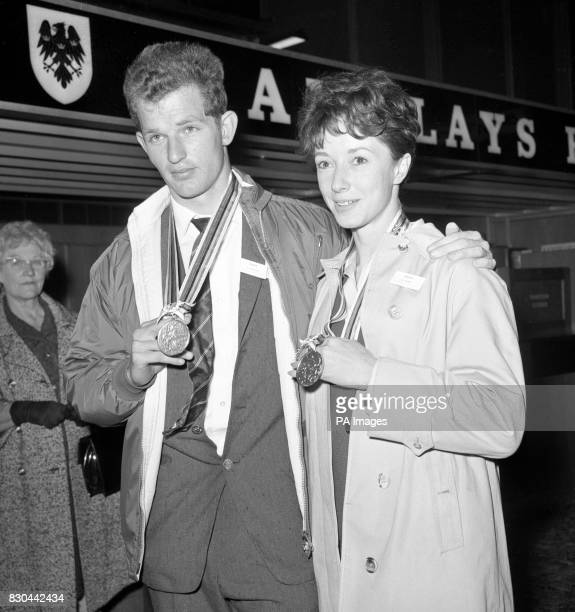 British olympic athletic captain Robbie Brightwell and his wife Ann Packer display their Olympic medals upon arrival at Heathrow Airport Ann won a...