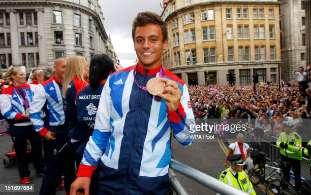 British Olympic bronze medal winning diver Tom Daley smiles during the London 2012 Victory Parade for Team GB and Paralympic GB athletes on September...