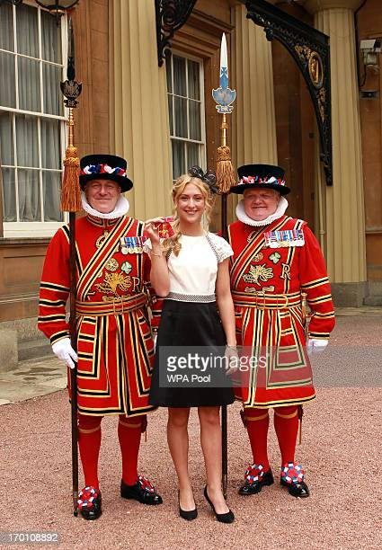 British Olympic cyclist Laura Trott with members of the Yeoman of the Guard after receiving her OBE medal from the Prince of Wales at an Investiture...