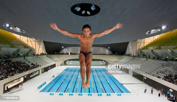 British Olympic diver Tom Daley performs a dive into the dive pool at the Aquatics Centre venue for the London 2012 Olympic Games at the Olympic Park...