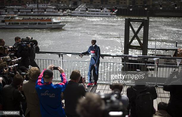 British Olympic double gold medallist Mo Farah poses for photographers in central London on April 18 2013 during a photo call ahead of the London...