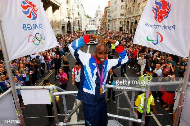 British Olympic gold medal winning athlete Mo Farah does the 'Mo Bop' as he takes part in the London 2012 Victory Parade for Team GB and Paralympic...
