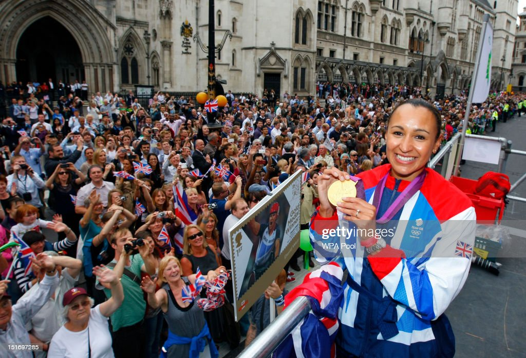 British Olympic gold medal winning Heptathlete Jessica Ennis holds her gold medal as she takes part in the parade passing Royal Courts of Justice during the London 2012 Victory Parade for Team GB and Paralympic GB athletes on September 10, 2012 in London, England.