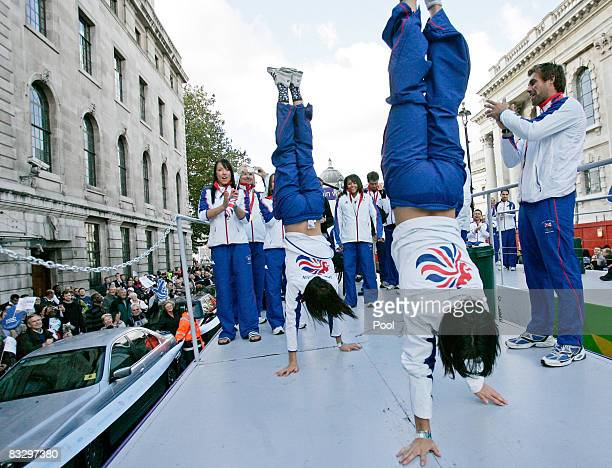 British Olympic gymnasts Rebecca Wing and Becky Downie demostrate their skill on the float as gold medallist in Star sailing Iain Percy cheers them...