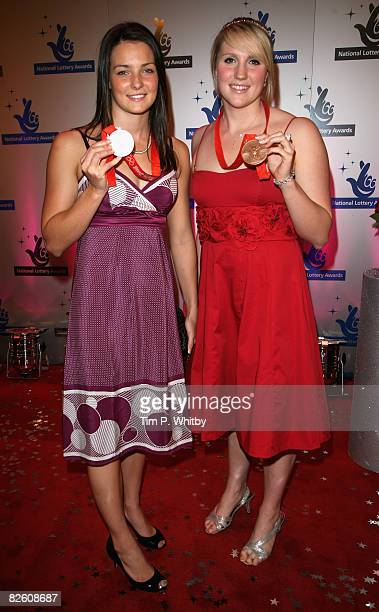 British Olympic medalists swimmers KeriAnne Payne and Cassie Patten pose with their medals on arriving at The National Lottery Awards the annual...