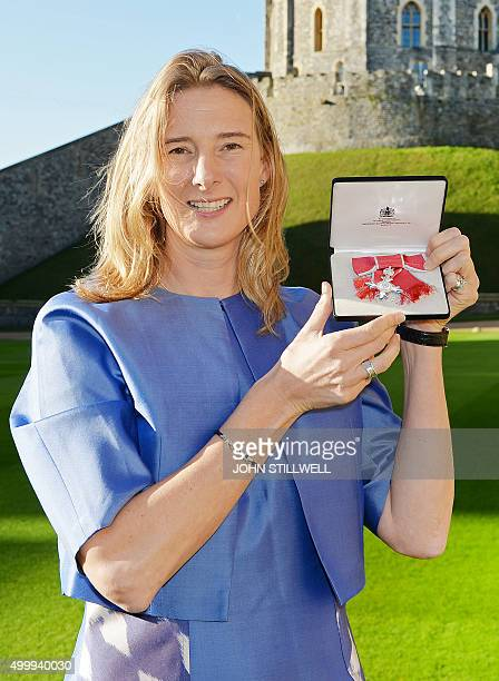 British olympic rower Sarah Winckless poses with her Member of the Order of the British Empire after she was presented with it by Britain's Queen...