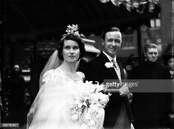 British Olympic skier Peter Lunn and the Hon Antoinette Preston , after their wedding at St. James's, Spanish Place, London, 24th April 1939. After...