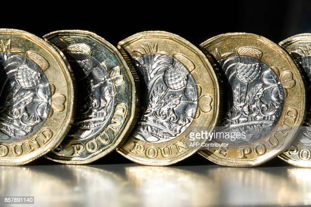 British one pound sterling coins are arranged for a photograph in central London on October 5 2017 The British pound was under pressure on October 5...