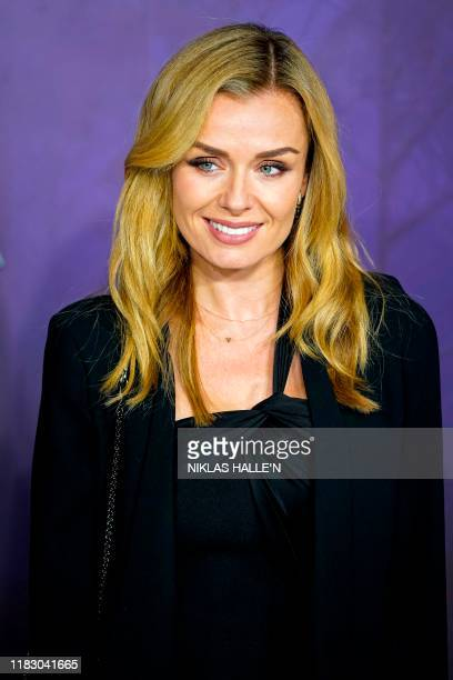 British opera singer Katherine Jenkins poses on the red carpet as he arrives to attend the European premiere of the film Frozen 2 in London on...