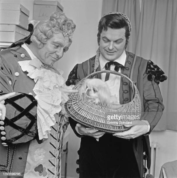 British opera singers Geraint Evans and Peter Glossop with a dog called Nina, UK, 20th March 1967. The two men are appearing as Doctor Bartolo and...