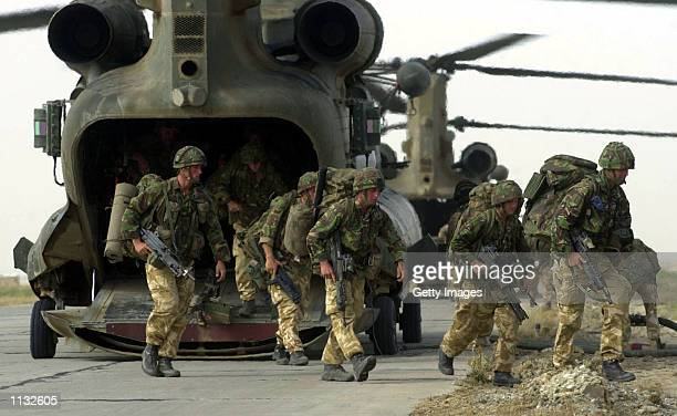 British Operation Buzzard officially ends as Royal Marines of 45 Commando 'Yankee' disembark a Chinook helicopter on their return to Bagram airbase...
