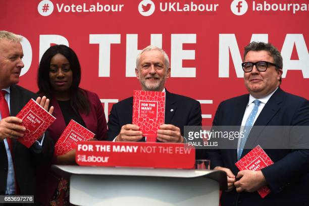 British opposition Labour party leader Jeremy Corbyn poses with a copy of the Labour election manifesto after the launch in Bradford on May 16 2017...