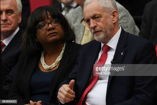 British opposition Labour party leader Jeremy Corbyn sits next to shadow Home Secretary Diane Abbott during the Labour election manifesto launch in...